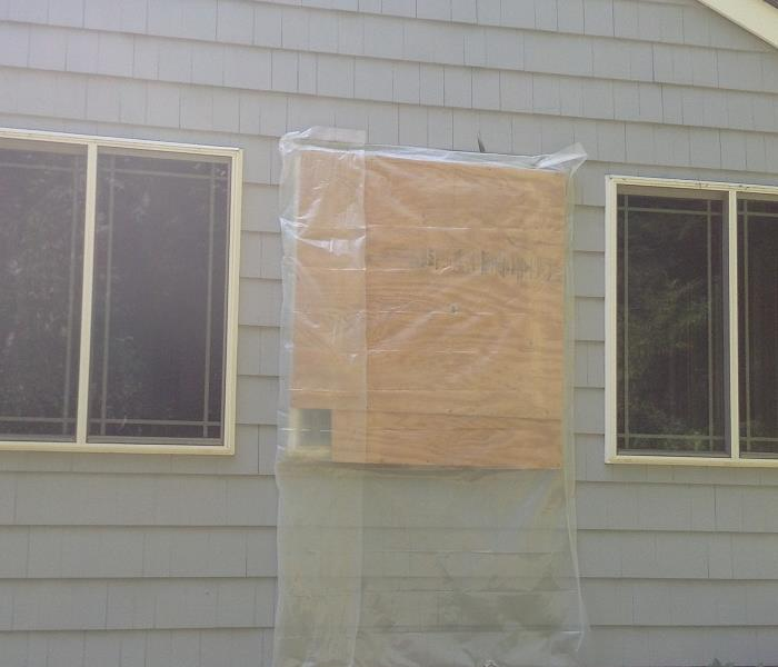 Boarding up windows after tree damage in Fairfield County