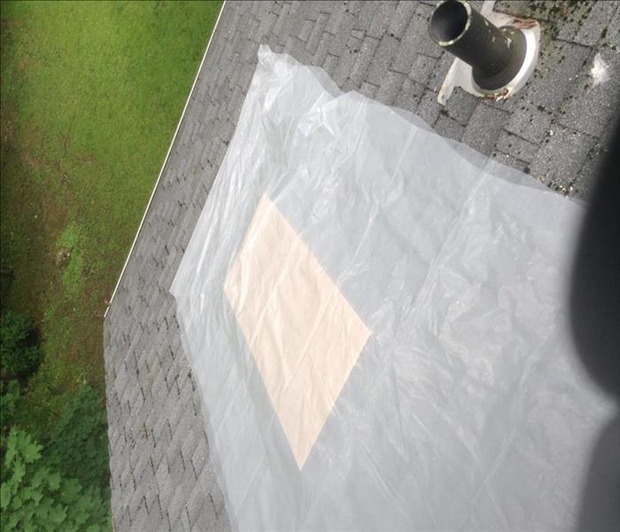 Storm Damage causes hole in roof to home in Brookfield, CT