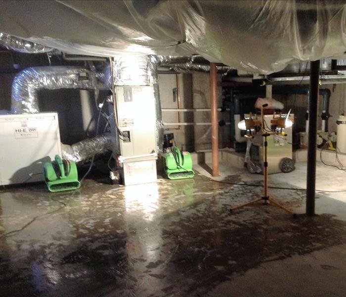Water damage from refrigerator line leak causes basement flooding in Danbury, CT