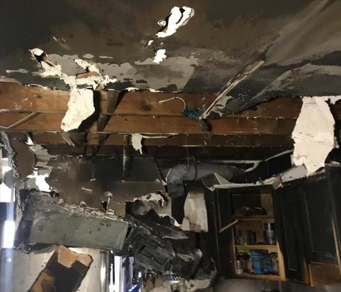 burned ceiling falling down in a kitchen