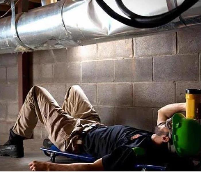servpro employee inspecting ductwork