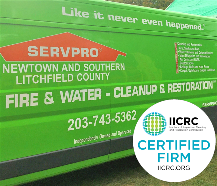 green van with servpro of Newtown and southern litchfield county name and number on it with IICRC logo